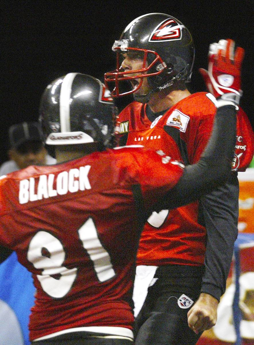 SPORTS - Gladiator quarterback Clint Dolezel celebrates his game sealing touchdown in the fourt ...