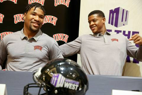 UNLV quarterback Armani Rogers, left, and linebacker Javin White talk to reporters during Mount ...