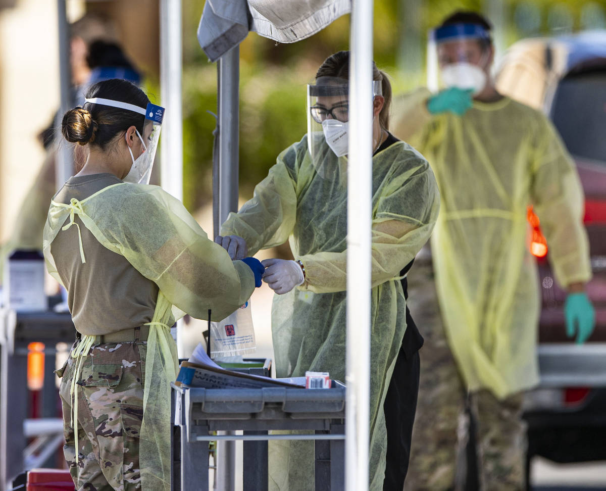 Members of the National Guard assist the UNLV School of Medicine with administering COVID-19 te ...
