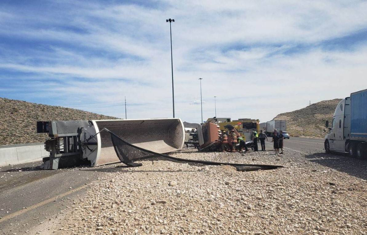 Troopers investigate a gravel truck rollover Wednesday, April 29, 2020, on southbound Interstat ...