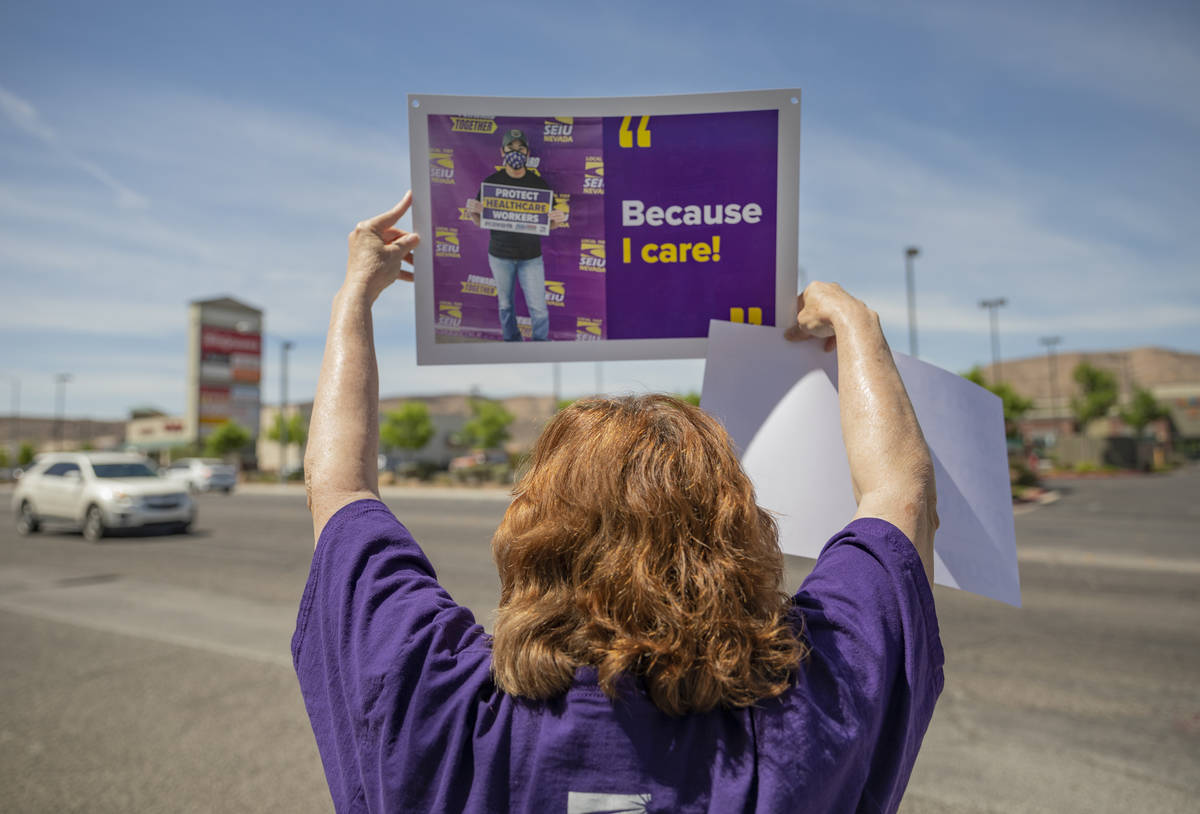 A Local SEIU 1107 member honors other frontline health care workers and list demands for more p ...