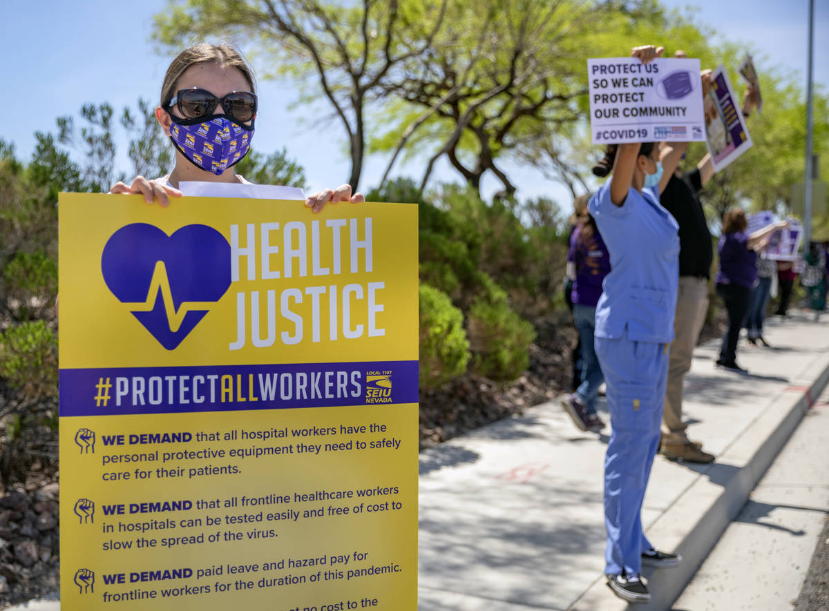 Yarleny, left, and other Local SEIU 1107 members, honor other frontline health care workers and ...