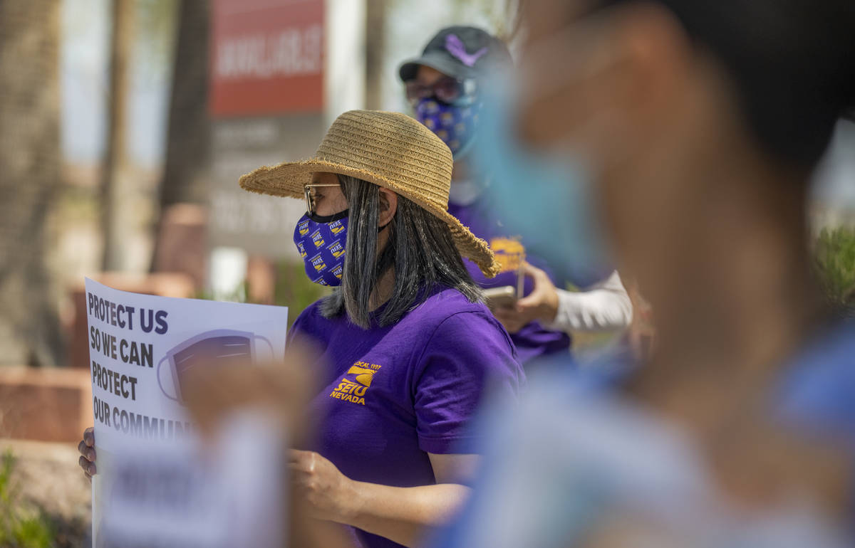 Grace Vergara-Mactal, executive director of Local SEIU 1107, holds a sign in protest of unsafe ...