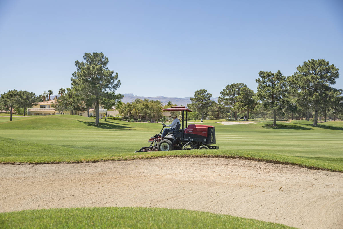 Groundskeeping is done to prepare for the opening of the Spanish Trail Country Club and Golf Co ...