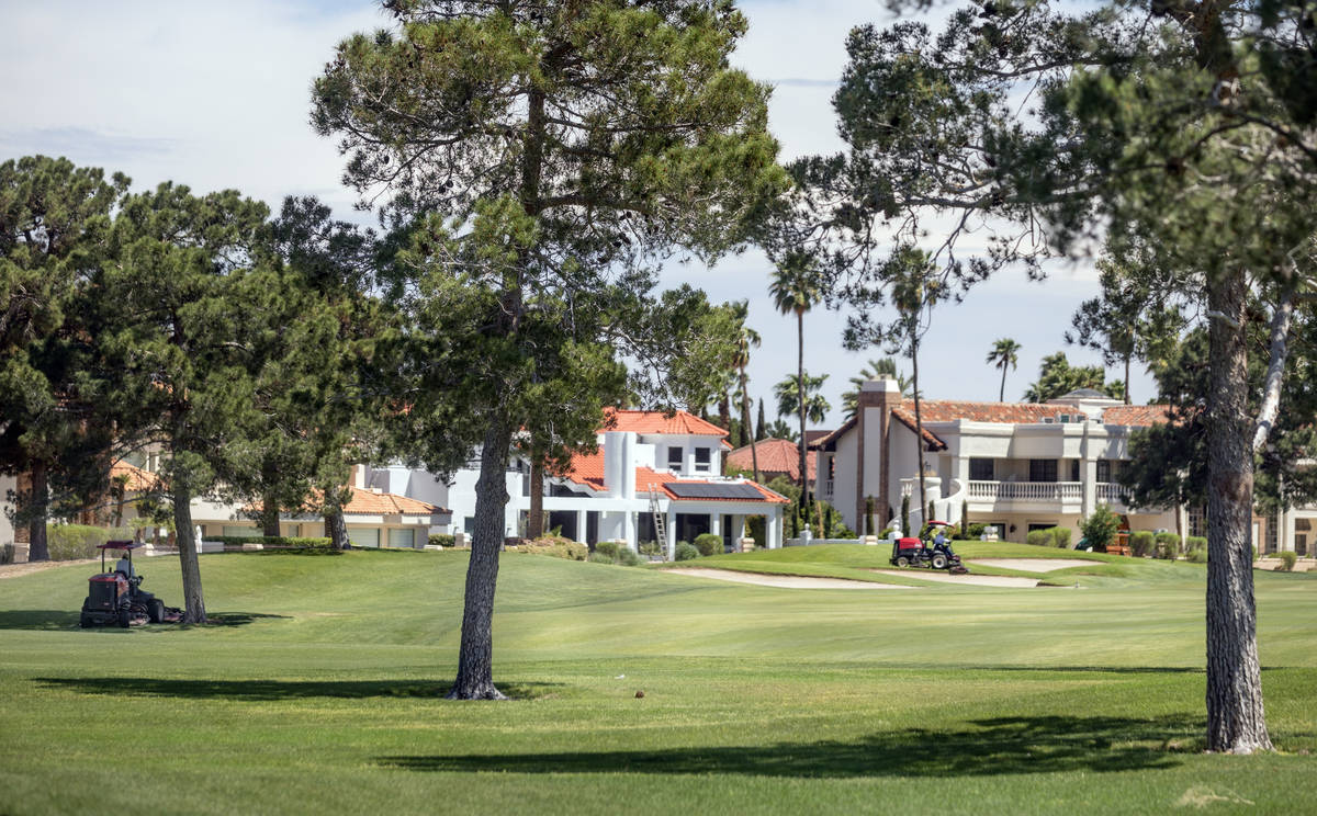 Groundskeepers prepare for the opening of the Spanish Trail Country Club and Golf Course in Las ...