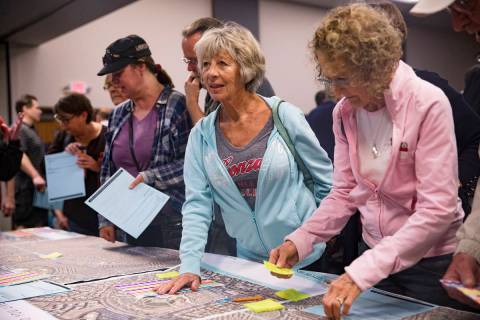 Lois Anderson speaks with city officials at a meeting the city hosted to provide information an ...