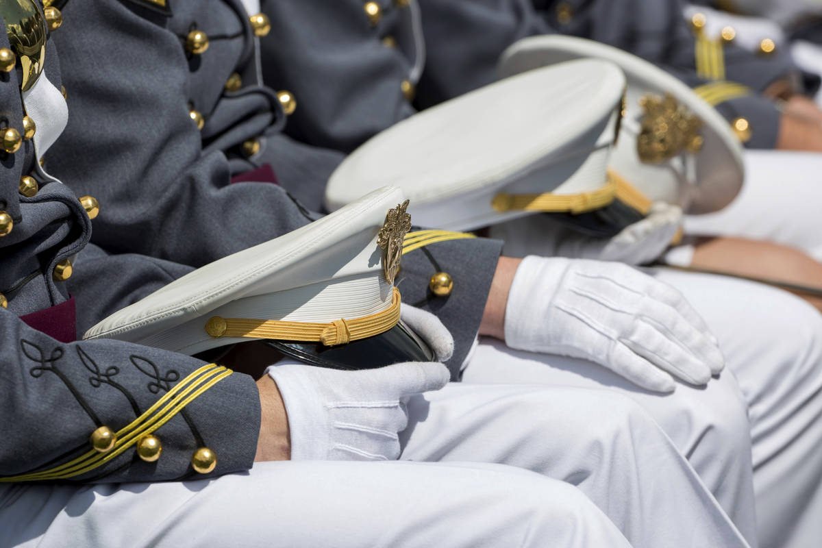 FILE - In this May 25, 2019, file photo West Point cadets hold their caps on their laps during ...
