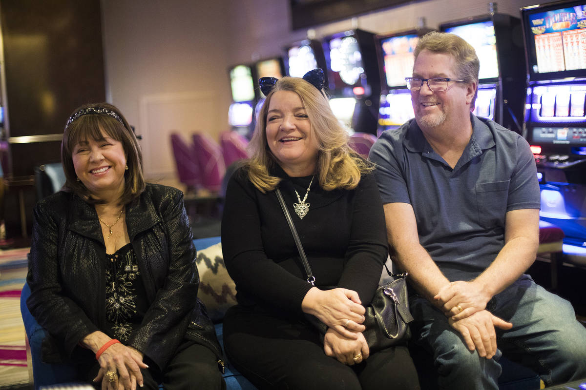 Diana Evoni, from left, Heidi Clemmons and her husband Fred Clemmons talk to the Review-Journal ...