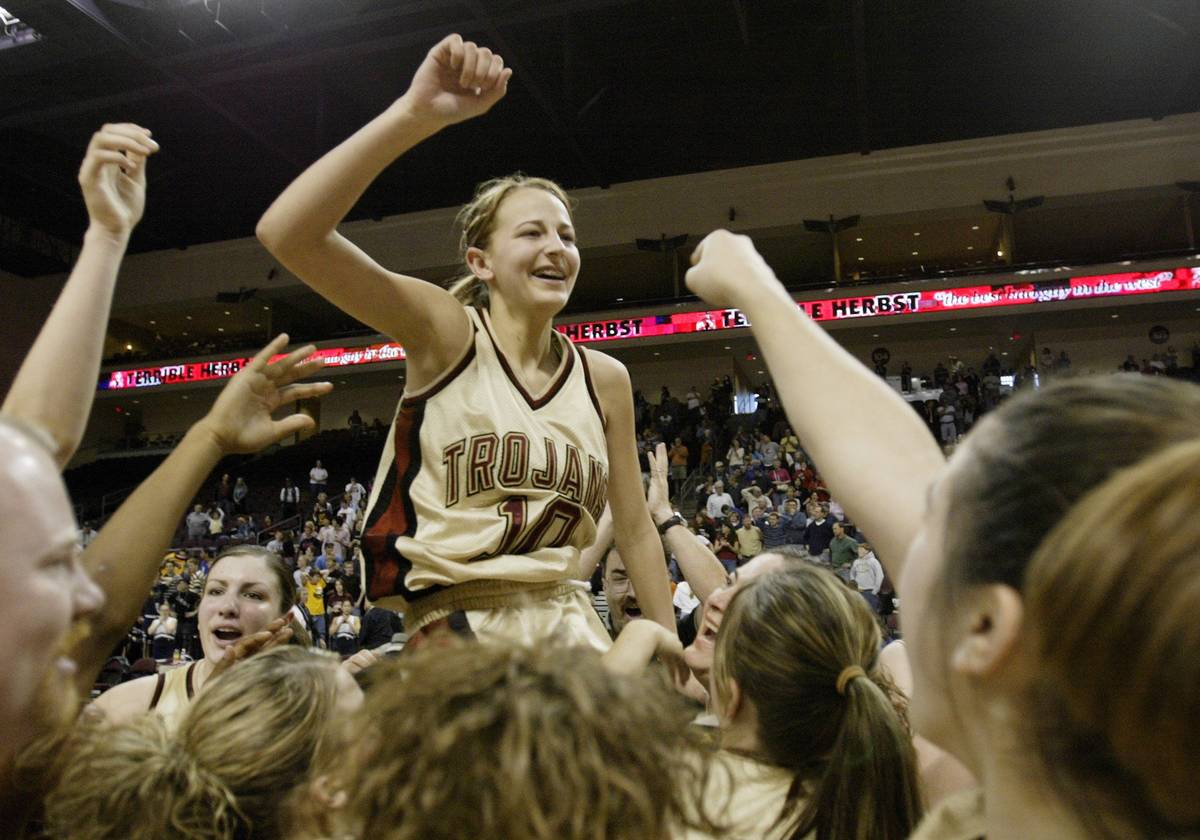 Pahrump Vally girls lift up Melanie Maeder #10 after she hit a three-pointer at the buzzer to w ...