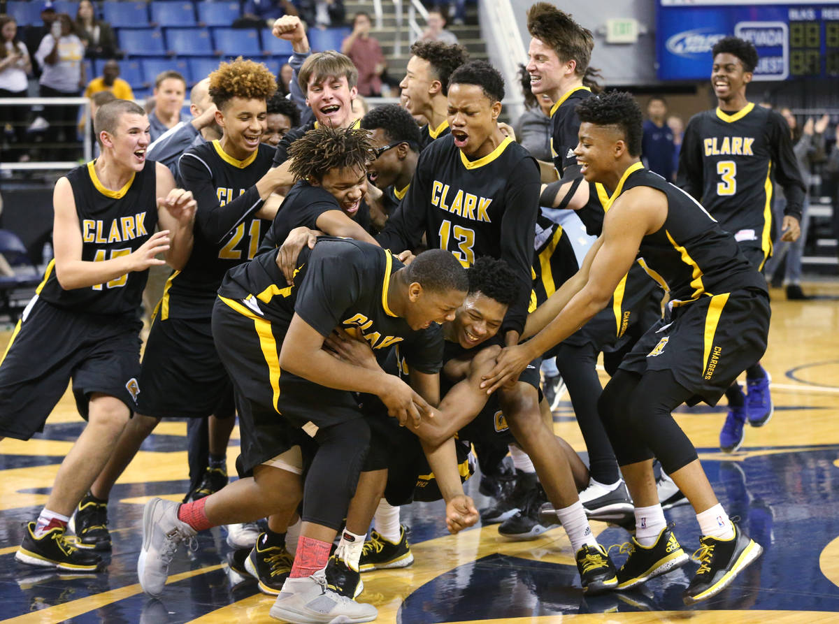 Clark celebrates its 43-39 over Desert Pines in the NIAA Division I-A state basketball champion ...