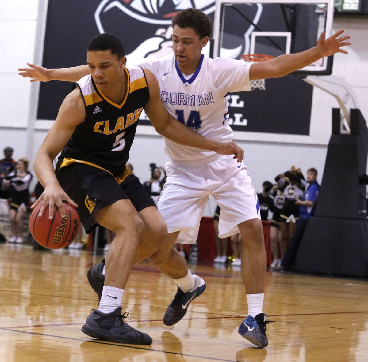 Clark's Deshawn Wilson (5) dribbles against Bishop Gorman's Saxton Howard (14) during the secon ...