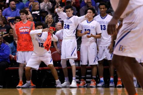 Bishop Gorman players react after one their teammates scores against Clark during the second ha ...