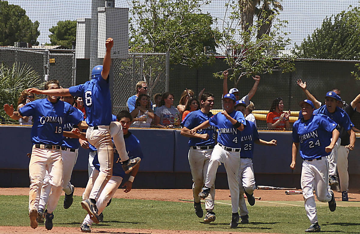 Bishop Gorman baseball players celebrate their victory over Galena High School in the State Ch ...
