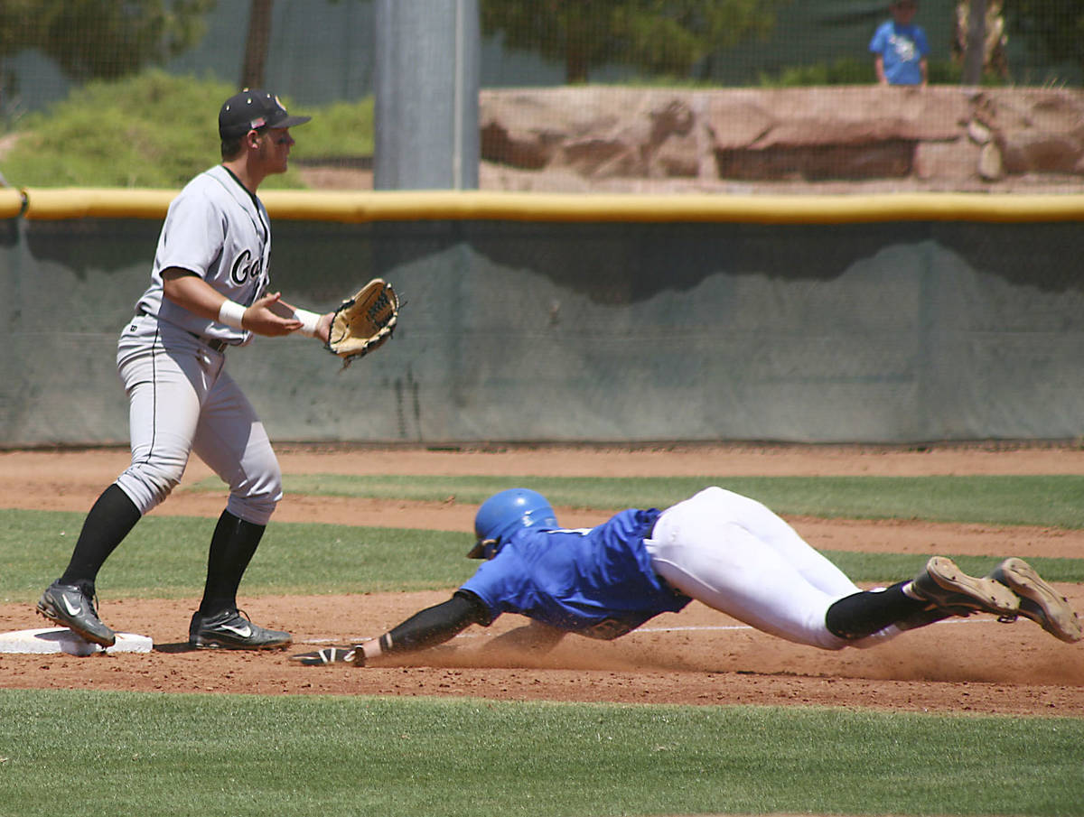 BIshop Gorman Pitcher Jeff Malm slides head first into 3rd base during the state championship g ...