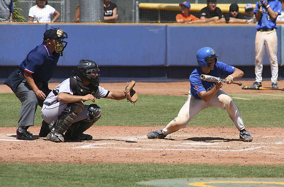 Bishop Gorman catcher John Rickard tries to lay down a bunt during the state championshipgame w ...