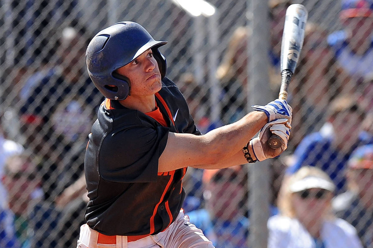 Bishop Gorman shortstop Cadyn Grenier (2) hits a walk-off home run against Green Valley in the ...