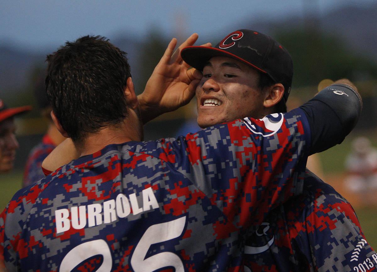 Coronado High School players Chandler Blanchard, right, and Julian Burrola celebrate after defe ...