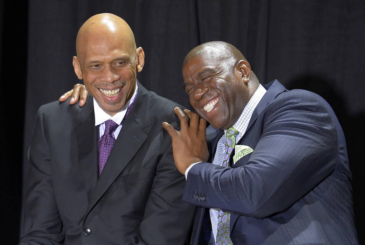 "Former Los Angeles Laker Earvin ""Magic"" Johnson, right, hugs former teammate Kareem A ..."