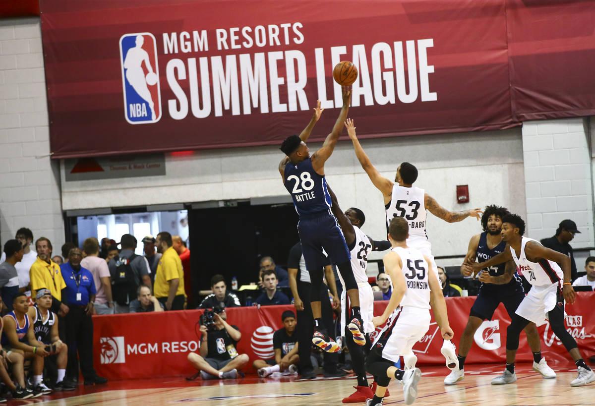 Minnesota Timberwolves' Tyus Battle (28) shoots over Miami Heat's Nick Weiler-Babb (53) during ...