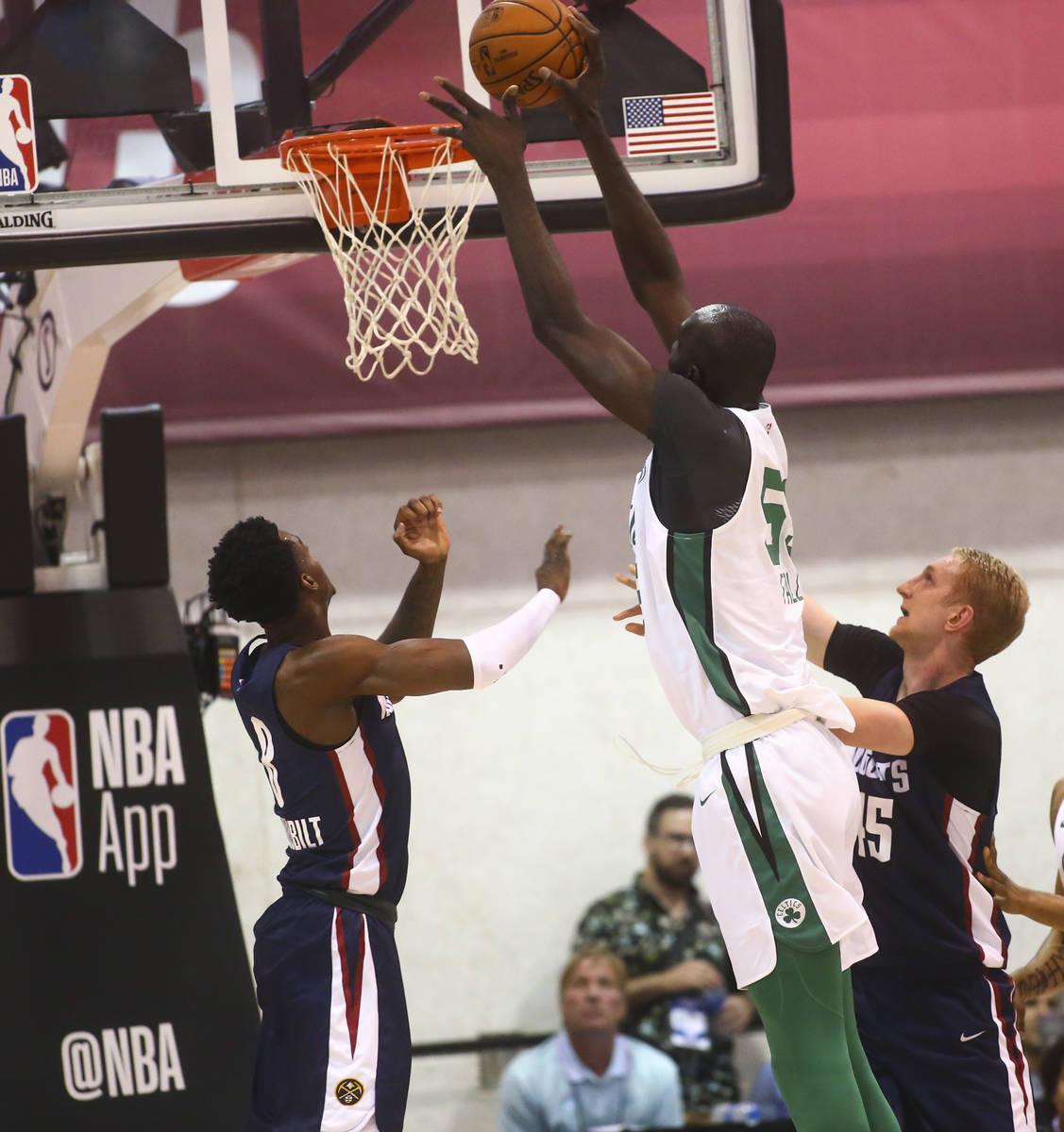 Boston Celtics' Tacko Fall (55) shoots over Denver Nuggets' Jarred Vanderbilt during a basketba ...
