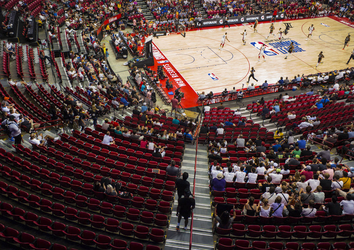 Basketball fans watch the first half of a basketball game between the Atlanta Hawks and the Was ...