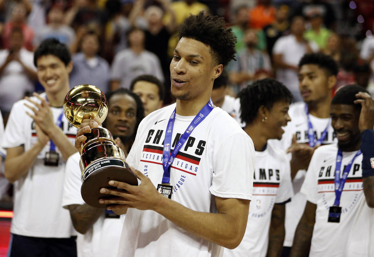Memphis Grizzlies' Brandon Clarke, foreground, holds the championship game MVP trophy after def ...