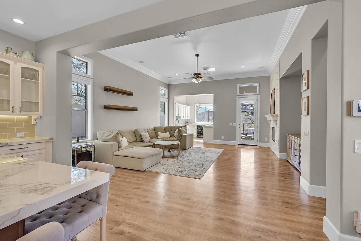 The medium-tone, luxury, vinyl-plank flooring is throughout the house. (Huntington & Ellis)