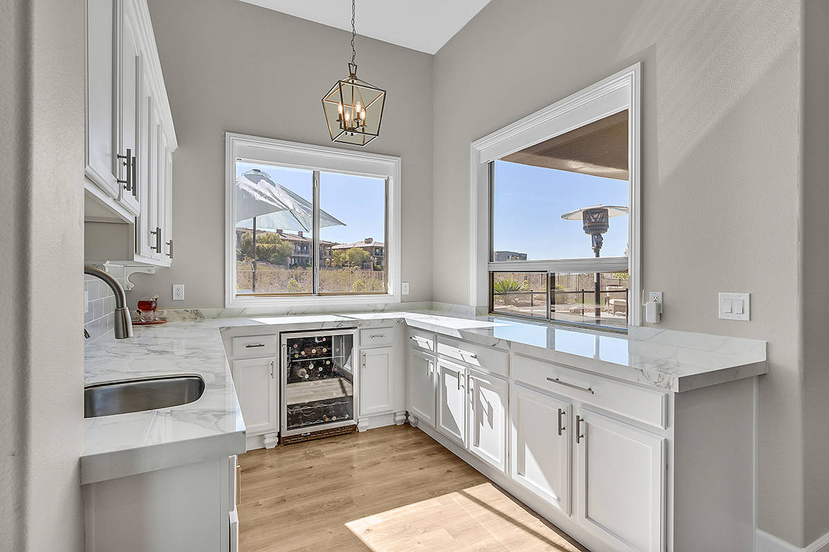 A large island resides in the center of the kitchen and features porcelain countertops. (Huntin ...