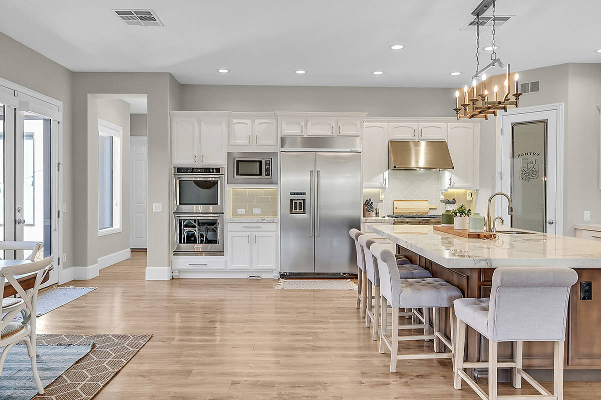 The kitchen, where the family spends a lot of time, is equipped with KitchenAid appliances. (Hu ...