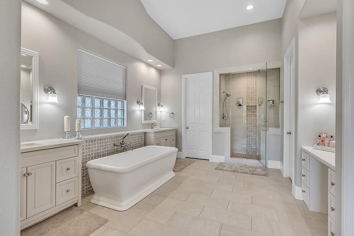 The master bath features a soaking tub and quartz countertops. (Huntington & Ellis)