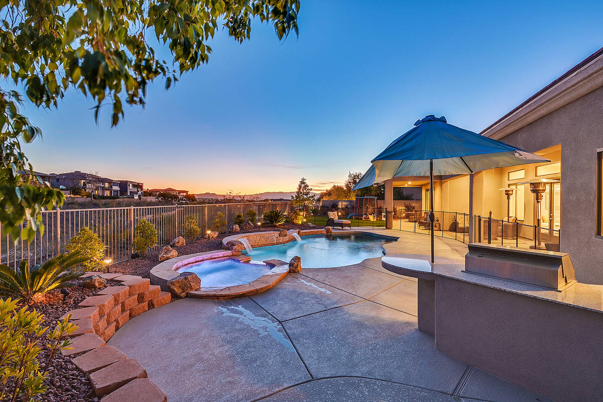 The Anthem Country Club home has a pool, spa and patio in the backyard. (Huntington & Ellis)