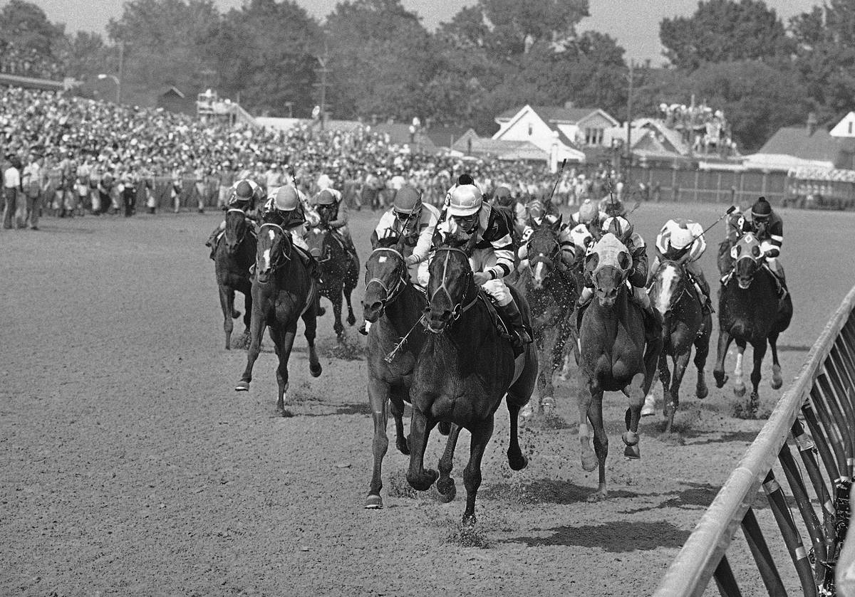 FILE - In this May 7, 1977, file photo, Seattle Slew, with Jean Cruguet up, crosses finish line ...