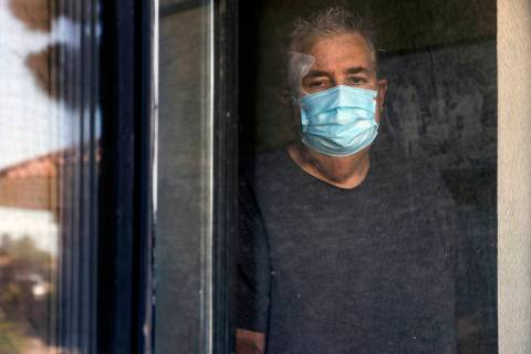 Richard Haacke, from behind the window of his room, is a patient at the College Park Rehabilita ...