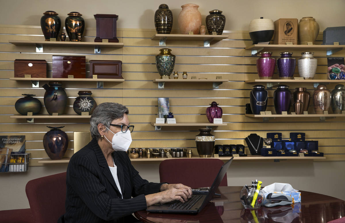 Laura Sussman of Kraft-Sussman Funeral & Cremation Services at a desk within their display ...