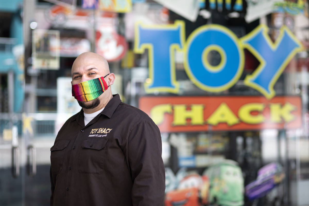 Johnny Jimenez Jr., owner of Toy Shack, stands for a portrait next to his store in the Neonopol ...