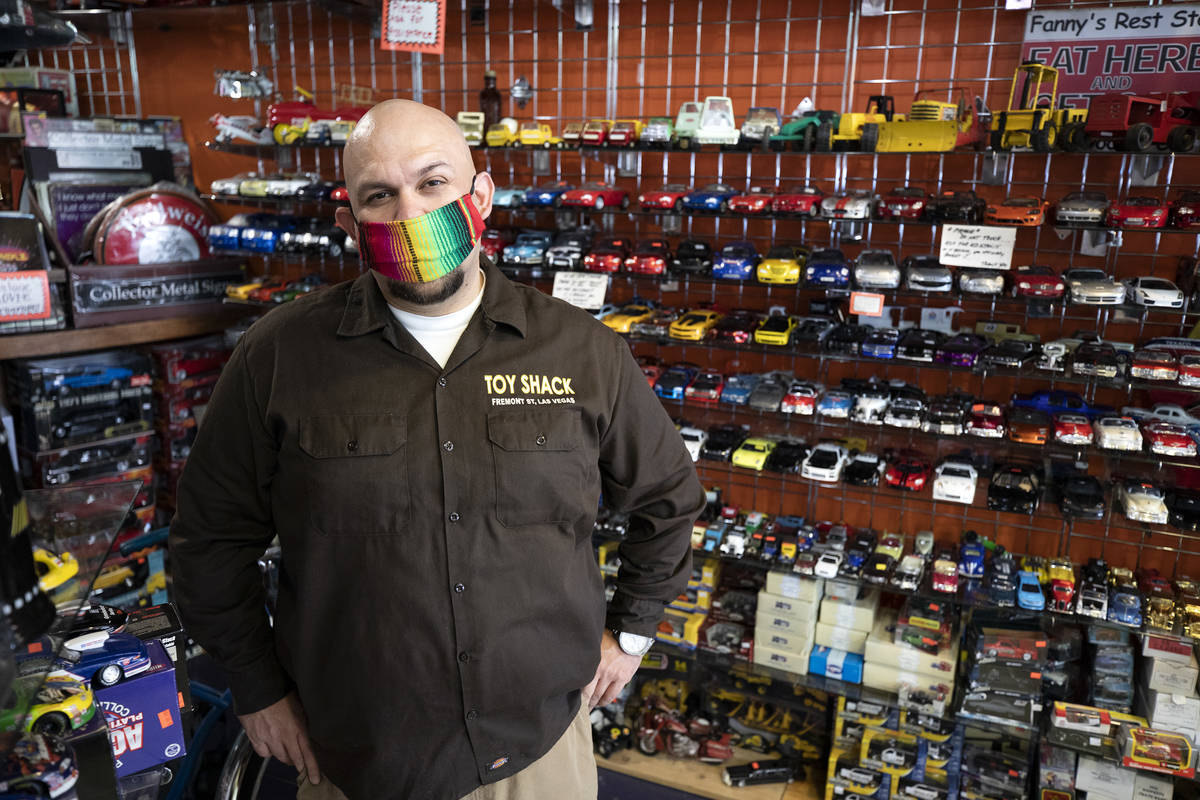 Johnny Jimenez Jr., owner of Toy Shack, stands for a portrait in his store in the Neonopolis sh ...
