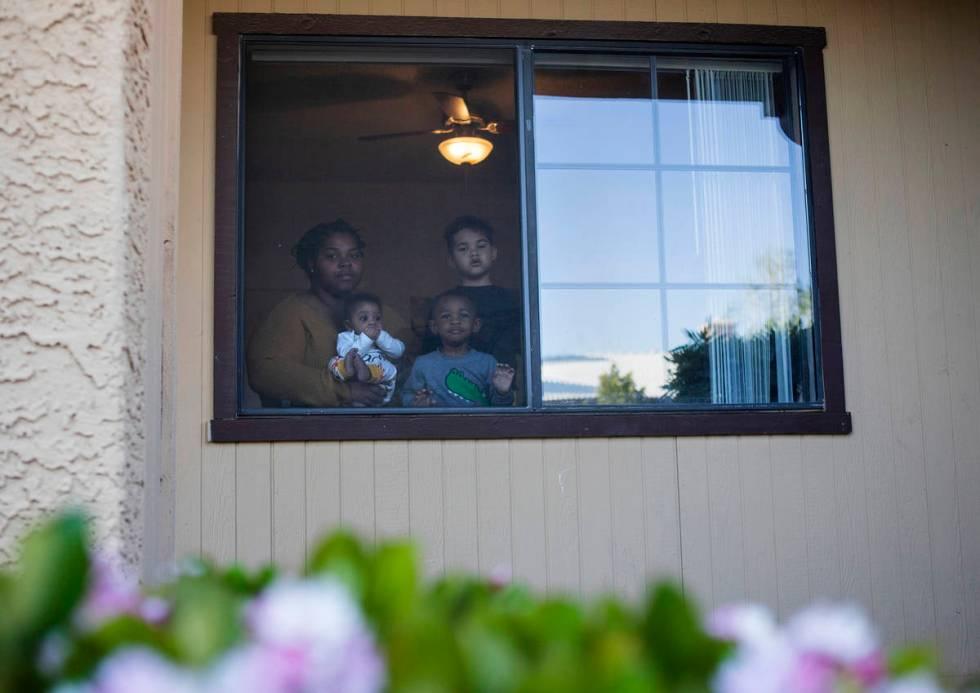 Vanavia Weatherly and her three children of Las Vegas. (Ellen Schmidt/Las Vegas Review-Journal) ...