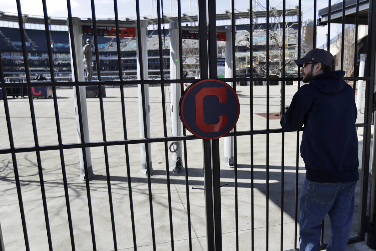 In this March 26, 2020, file photo, Jason Hackedorn looks into Progressive Field, home of the C ...
