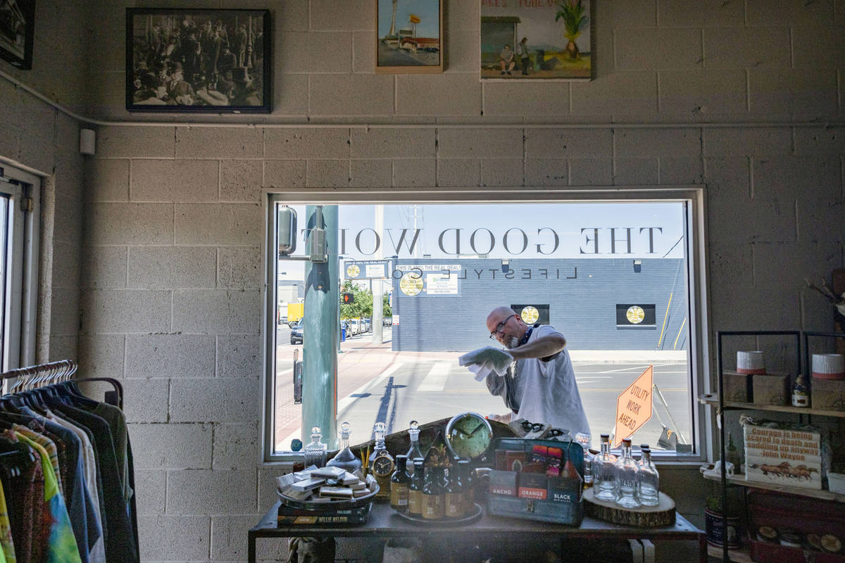 Erik Cerza, owner of I Love Windown cleaning company, cleans the windows at the Good Wolf Lifes ...