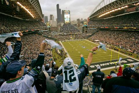 Seattle Seahawks fans cheer and wave their 12th man towels during the opening kickoff of the Se ...