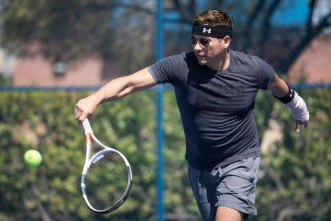 Daniel Nunez plays tennis with his girlfriend at Darling Tennis Center on Friday, May 1, 2020, ...