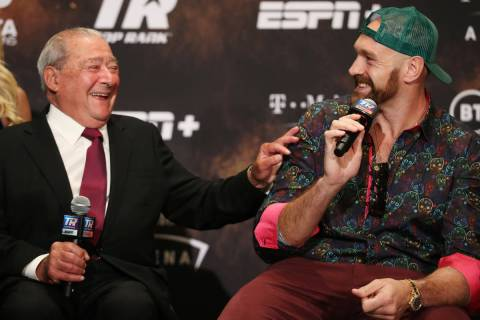 Boxing promoter Bob Arum, left, and Tyson Fury, share a laugh during a press conference at the ...