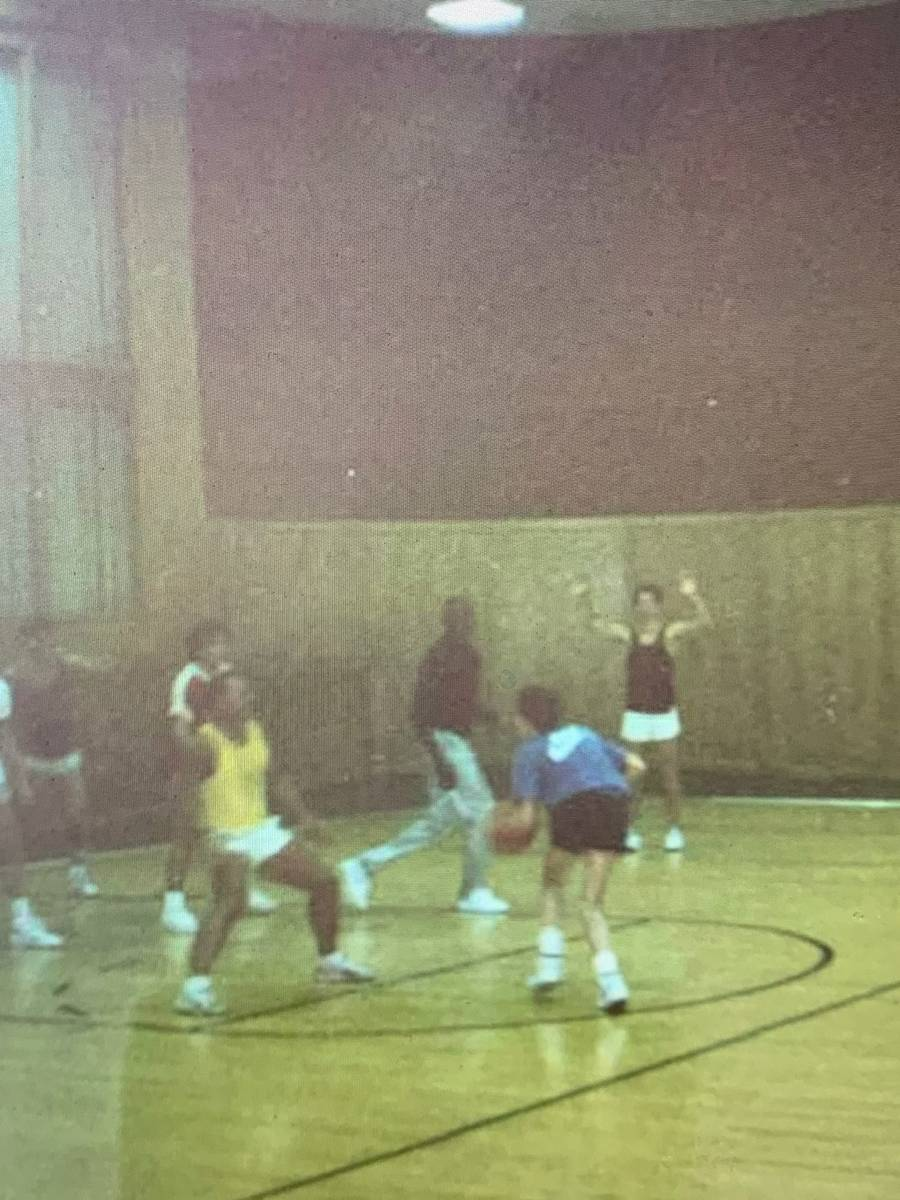 Michael Jordan, middle (black shirt, silver pants) is shown in a Polaroid snapshot playing pick ...