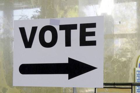 A sign points the way to the polling station. (Review-Journal File)