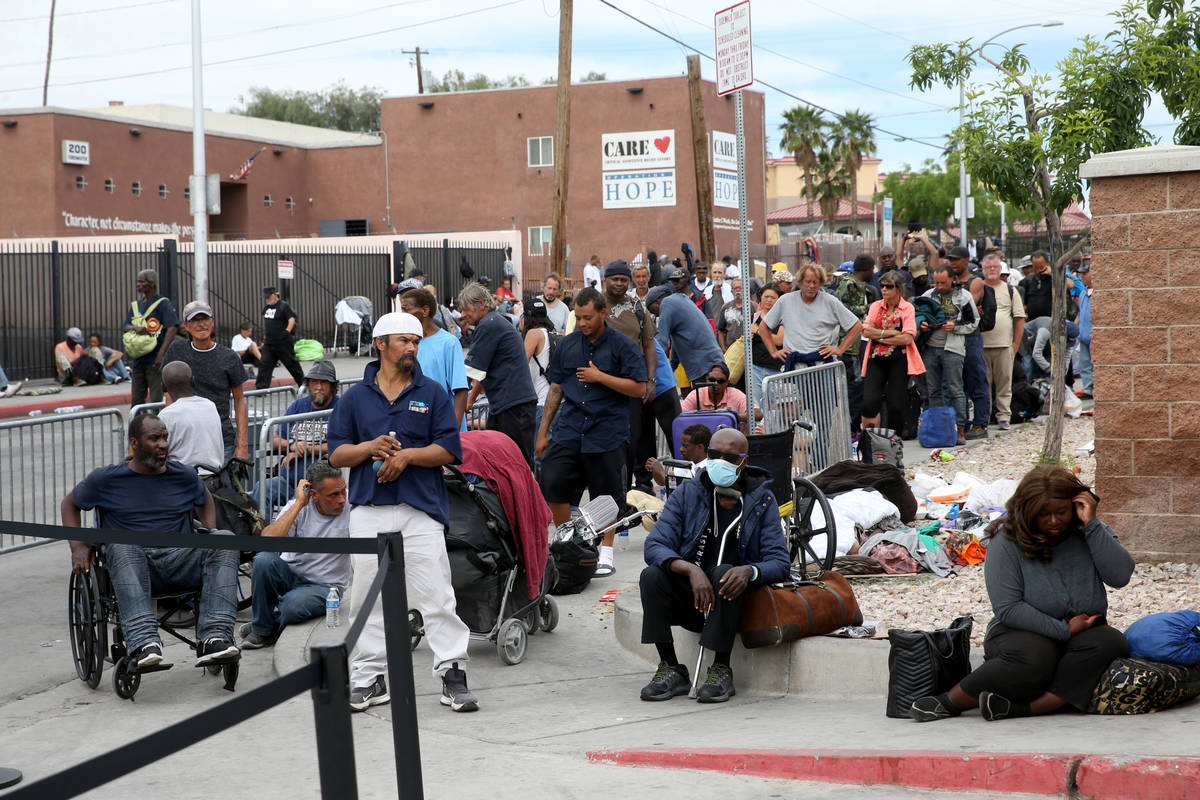People line up for a meal at Catholic Charities on Foremaster Lane between Las Vegas Boulevard ...