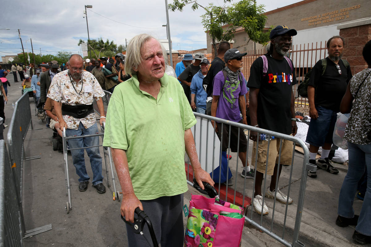 Robert Godleski, 73, lines up for a meal at Catholic Charities on Foremaster Lane between Las V ...