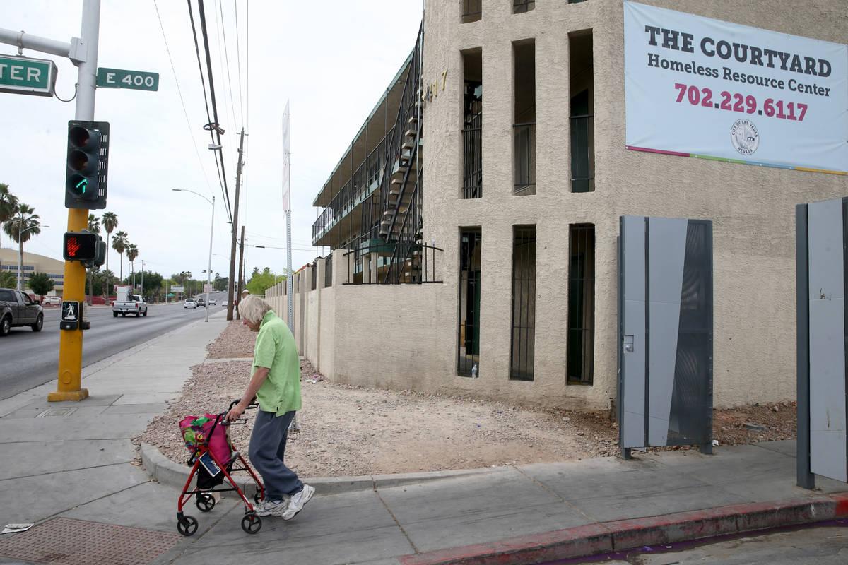 Robert Godleski, 73, makes his way down Foremaster Lane at Las Vegas Boulevard in downtown Las ...