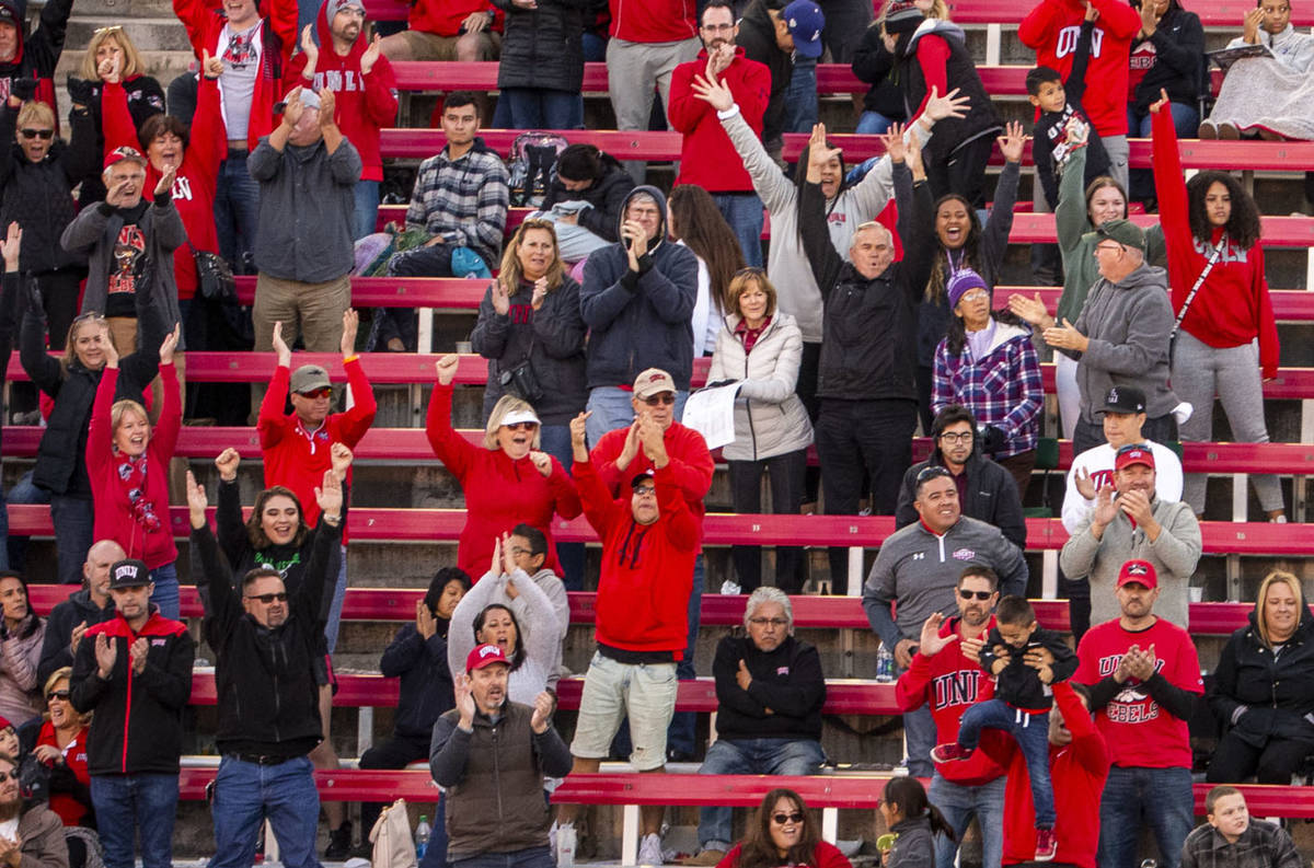 UNLV fans celebrate a go-ahead touchdown late versus the San Jose State Spartans during the fou ...