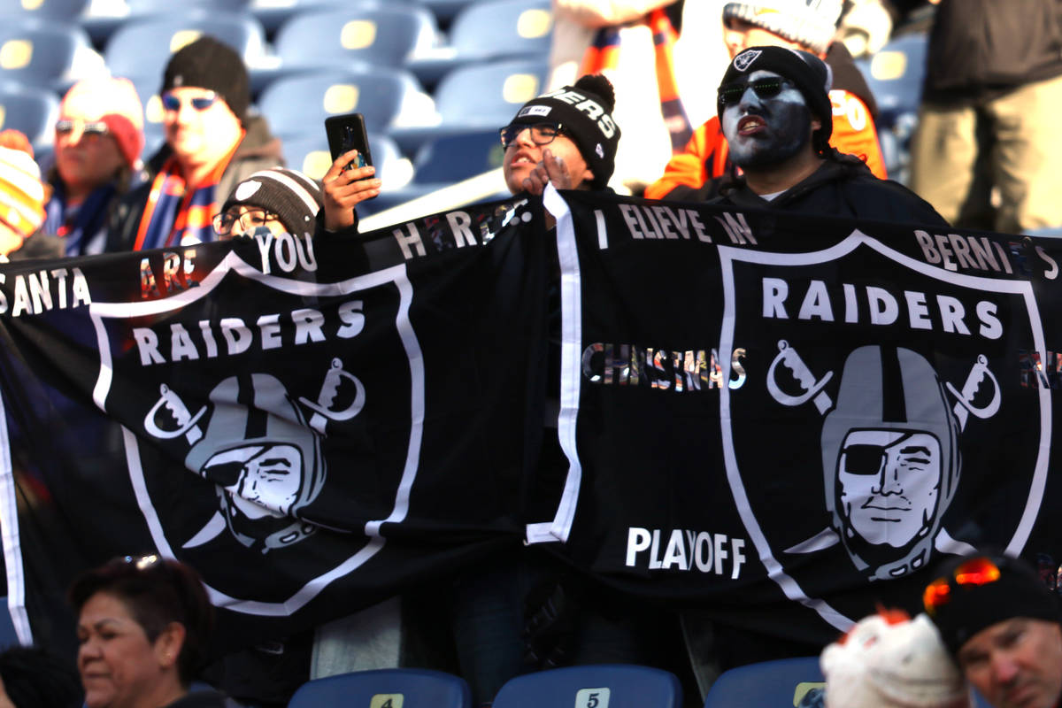 Oakland Raiders fans wave their flag prior to an NFL game against the Denver Broncos at Empower ...