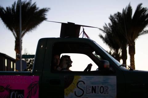 The sun goes down behind a drive-through parade for senior night at Coronado High School on Fri ...